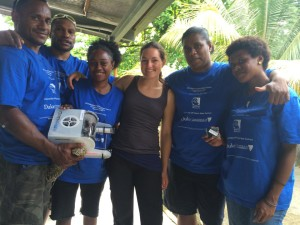 Erika with some of the PNG students involved in the program and one of the first mini-ROVs to be built in PNG